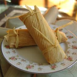 Beef Tamales Recipe - These are just like the tamales my Abuelita used to make for special occasions. This recipe makes a lot, but if you're going to go to all the trouble of making tamales from scratch, you might as well have a party! You will need butchers' twine and a large pot with a steamer basket to make these. May be frozen up to 6 months in heavy-duty resealable plastic bags. To reheat, thaw in refrigerator and then steam or microwave until heated through.
