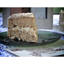 Incredibly Delicious Italian Cream Cake Recipe - This tender coconut cake is made with buttermilk, topped with a cream cheese coconut frosting and chopped nuts.