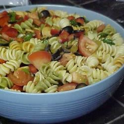 Salsa Pasta Salad Recipe - A zesty shake of vinegar, cilantro, garlic salt, lemon juice, oil and sugar dances with pasta tossed with onion, bell pepper, olives, tomatoes and green chilies. Let the salad chill for a while to bring out all the festive flavors.