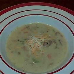 Marilyn's Cheesy Clam Chowder Recipe - A little different twist on an old favorite...cheese makes the difference! Substitute half and half cream for a richer chowder.