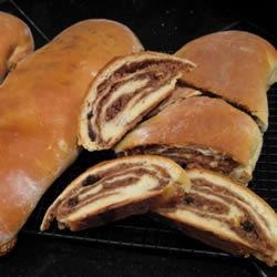 Walnut Poteca Recipe - These yeast loaves are rolled up around a honey-walnut filling. The recipe makes a lot, since it's a lot of work--but the rolls freeze well, and are worth the effort!