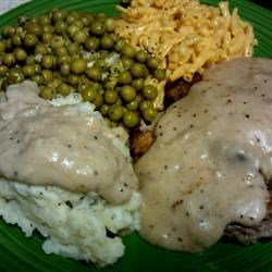 Chicken Fried Steak with Cream Pork Sausage Gravy Recipe - For a special treat, nothing beats a tender chicken-fried beef tenderloin steak, smothered in rich cream sausage gravy.