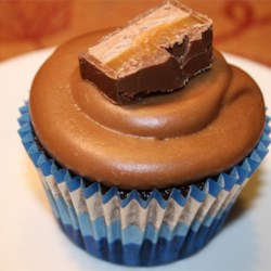 Milky Way(R) Cupcake Icing Recipe - Melted milk chocolate covered caramel and nougat candy bars are transformed into a rich and creamy cupcake icing.