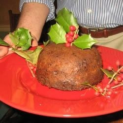 Plum Pudding II Recipe - This is a steamed pudding of brown sugar, butter, milk, flour, dates, raisins, currants, and candied fruit peel.  Serve it with custard, whipped cream or ice cream.