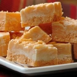 Orange Cream Fudge Recipe - This simple recipe combines cream, butter, marshmallow creme, white chocolate and orange extract to make this classic favorite.