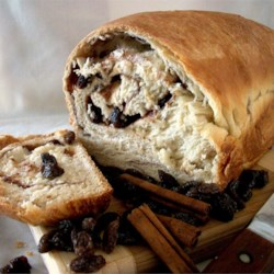 Cinnamon Raisin Bread I Recipe - Raisin bread the way it is meant to be -rolled around the sweetened cinnamon butter so that the spice ribbons throughout the loaf. This generous recipe will give you three lovely loaves.