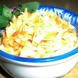 Quick and Easy Thai Style Coleslaw Recipe - This recipe is incredibly easy. A coleslaw with a sweet and tangy blend of Asian flavors. Takes about 5 minutes to make!  Make it early in the afternoon, and it will be a great with dinner.  Refreshing and delicious - an ideal summer side dish!