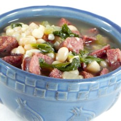 Sausage, Kale, and White Bean Soup Recipe - A comforting bean soup with spicy sausage and leafy kale. Easy to put together and delicious on a cold winter's day. You can substitute other sausage, onion instead of shallots, and other greens for the kale, and it will still be tasty!