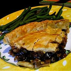 Easy Beef Pie Recipe - Sauteed stew meat is combined with red wine, canned vegetables, and canned beef gravy, then placed in a pastry shell and topped with a second pastry shell for baking.