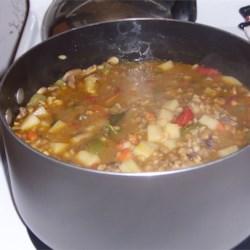 Barley, Lentil and Mushroom Soup Recipe - This is a hearty soup made with whole grains and mushrooms simmered in a beef broth. It goes great with a crusty bread and salad.