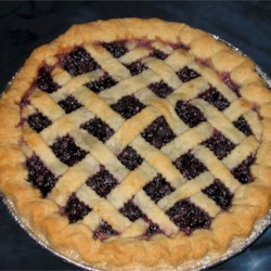 Fresh Blueberry Pie I Recipe - It's obvious that blueberries favor lemons once you make this classic pie. Fresh lemon juice and lemon zest are spooned over the sweetened berries, and then this berry filling is piled into a pastry crust, dotted with butter, covered with a top crust and baked.
