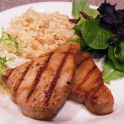Grilled Teriyaki Tuna Recipe - Yellowfin tuna marinated in teriyaki sauce and garlic, then grilled to perfection. This is great at a tailgate party, or at your Saturday afternoon summer barbecue.