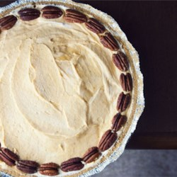 Pumpkin Cream Pie Recipe - This pie is so easy to make. Vanilla pudding, pumpkin puree, spices, milk and whipped topping are combined and beaten with an electric mixer until light and fluffy. The filling is then poured into a prepared crust and chilled for several hours. Serve it with whipped cream and a sprinkling of chopped pecans.