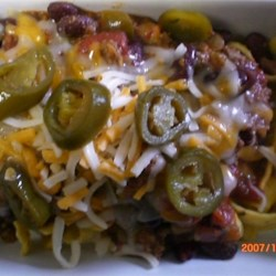 Ken's Texas Chili Recipe - This is a Texas style chili recipe with beans. It also uses hamburger rather than chuck. Leaving behind a small amount of the hamburger fat gives it that unique Texas chili taste.
