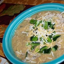 Restaurant-Style Cheesy Poblano Pepper Soup Recipe - Corn tortillas, flour and spices which have been combined in a food processor are used as a thickener in this flavorful chicken stock based soup with roasted Poblanos, chunks of chicken and half-and-half.