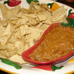 Mexican Style Dip Recipe - This Tex-Mex recipe was a big hit when brought it to work. My shift starts at 7 AM the dip was gone by 8 AM. With many requests for the recipe!