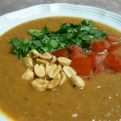 African Sweet Potato and Peanut Soup Recipe - Peanut flavor is balanced by warm spices and the earthy sweetness of sweet potatoes.