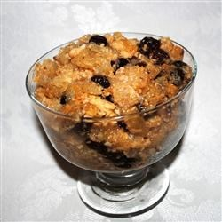 Rice Pudding I Recipe - Baked rice pudding flavored with nutmeg and cinnamon and flecked with raisins.
