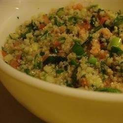 Tabbouleh III Recipe - This salad is light and flavorful and chock full of veggies that you can pull from your garden--tomatoes, cucumbers, and green onions. Add lots of parsley and mint and a nice splash of olive oil and lemon juice and that's it. Chill before serving to bring out the flavors. Serves eight.