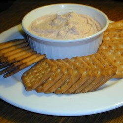 Salmon Spread I Recipe - This recipe is very good and so easy to make. I always serve it when I have a party. Succulent smoked salmon is blended into a creamy, flavorful mixture that's great on crackers or warm bagel slices.