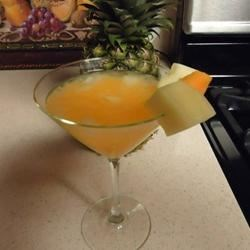 Triple Orange Sour Recipe - I just made this up one day with the ingredients I had.  With the martini craze, I decided to call it an orange martini, but it is just a good tropical drink for a summer day.