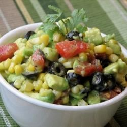 Avocado Salsa Recipe and Video - Cool, refreshing avocado slices are mixed with a marinated corn, olives, red pepper and onion salsa. Serve this south of the border flavor explosion with tortilla chips.