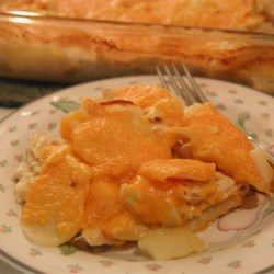 Cheesy Chicken and Potato Casserole Recipe -   Shredded chicken is incorporated into cheddar-y scalloped potatoes.