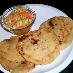 Pupusas de Queso (Cheese-Stuffed Tortillas) Recipe - A favorite El Salvadoran snack, homemade tortillas stuffed with fresh queso blanco cheese are often paired with a traditonal coleslaw called curtido. Farmer's cheese or mozzarella can be substituted for queso blanco.