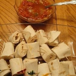 Tortilla Rollups III Recipe - An easy appetizer to take to a gathering! I use a dish that has a bowl in the middle and put the tortilla rollups all around the bowl. There are never any of these green chile pepper spiced treats left!