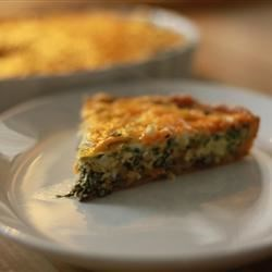 Spinach Quiche Recipe and Video - This savory deep-dish pie features herbed feta cheese that melts and mingles in every bite. The cheese is sauteed and mixed with spinach, mushrooms, Cheddar cheese and lots of garlic. This mixture is then combined with milk and eggs, and poured into a prepared crust. A bit more Cheddar cheese is sprinkled over the top, and then the quiche is slipped into the oven until it 's set.