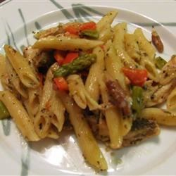 Asparagus, Chicken, and Pecan Pasta Recipe - Penne pasta tossed with asparagus, red peppers, pecans, and Parmesan cheese in a delicious sauce that is creamy without being over-powering. This has been a tremendous hit every time I've made it.