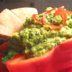 Spinach Artichoke Hummus with Roasted Red Peppers Recipe - Spinach artichoke dip and hummus come together in this savory dip. Serve it with pita chips or veggies.
