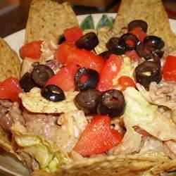 Messy Taco Salad Recipe - A wonderful picnic, potluck or 3-day dinner. Quick and easy and everyone seems to love it.  Optional toppings include chopped tomatoes and olives. I love to have this heated a bit the next day or two!!!