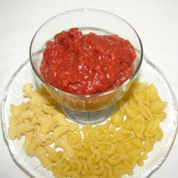 Homemade Tomato Sauce II Recipe - Try the real thing.  Delicious tomato, onion and garlic sauce with herbs.
