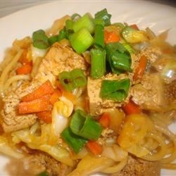 Sesame Asian Tofu Stir-Fry Recipe - A bright stir-fry of tofu, shredded carrots, bean sprouts, and thinly sliced green onions is served in a sweet tangy sauce with linguine pasta instead of rice. Sesame oil adds its nutty, savory flavor.
