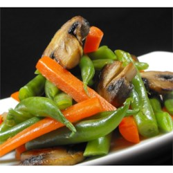 Green Bean and Mushroom Medley Recipe - Fresh green beans and carrots are sauteed with mushrooms and onions, in a host of savory spices.