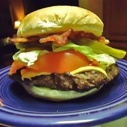 Juicy Deer and Bacon Burgers Recipe - Juicy deer burgers seasoned with beer and Worcestershire sauce are topped with bacon. The deer recipe you've been searching for.