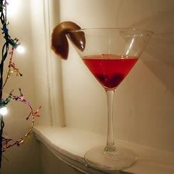 Pomegranate Martini II Recipe - You'll find an explosion of flavor in this vodka based martini - pomegranate, cranberry, raspberry, and orange.