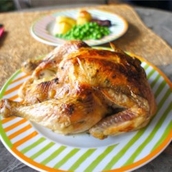 Succulent Roast Chicken Recipe - A moist, garlicky-lemony, easy roast dinner.  Serve with roast potatoes and veggies, and you've got yourself a wholesome and impressive meal!