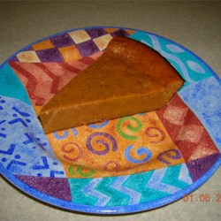 Impossible Pumpkin Pie I Recipe - This smooth, spicy pumpkin pie makes its own crust! Delicious with whipped topping or vanilla ice cream.