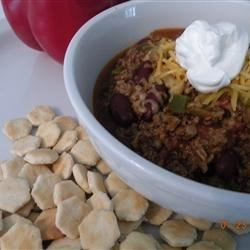 Slow Cooker Chili Recipe - Browned ground beef seasoned with chili powder is combined with canned tomatoes, kidney beans, chopped onions and green pepper in this easy recipe for chili.  Allow 4 hours cooking time.