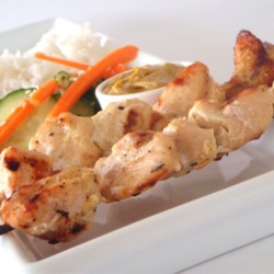 Easy Chicken Satay Recipe - These delicious chicken skewers are packed full of flavor! As if that wasn't enough, a tangy coconut-peanut sauce takes it over the top.