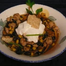 Chicken Tortilla Soup IV Recipe - Freshly fried strips of corn tortilla garnish this chicken, black bean and corn soup seasoned with cumin, chili powder and oregano.