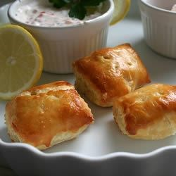 Salmon Puffs Recipe - Delightful salmon and feta cheese filling wrapped in puff pastry. I have substituted spinach and cooked tiny shrimp for salmon in this recipe too.