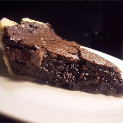 Tricia's Fantastic Fudge Pie Recipe -  Eggs, butter, flour and sugar are stirred together, and  combined with flour, unsweetened cocoa and oodles of chocolate chips. This batter is poured into a prepared crust and baked until everything melts and mingles. This pie is especially rich and decadent when served warm with huge scoops of vanilla ice cream.
