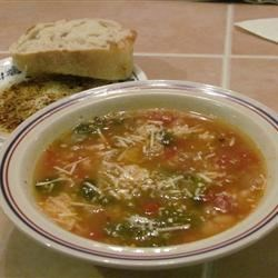 Dad's Escarole and Bean Soup Recipe - Tomatoes and cannellini beans simmer with escarole in this Italian-inspired soup.