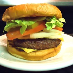 Brontosaurus Burgers Recipe - Big bold burgers for big appetites have a zing of hot sauce, and are brushed with barbecue sauce and grilled.