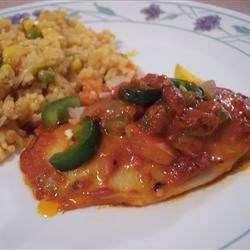 Baked Tilapia Recipe - Tilapia fillets taste great baked in a mildly spiced tomato sauce, and covered with green peppers and onions.