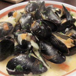 Steamed Mussels with Fennel, Tomatoes, Ouzo, and Cream Recipe - Fresh mussels are steamed in a cream broth flavored with fennel, tomato, and Greek ouzo.