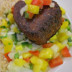 Blackened Tuna Steaks with Mango Salsa Recipe and Video - Tuna steaks are well-seasoned, lightly pan-fried, and served atop fresh-made mango salsa for a delicious and impressive main course.